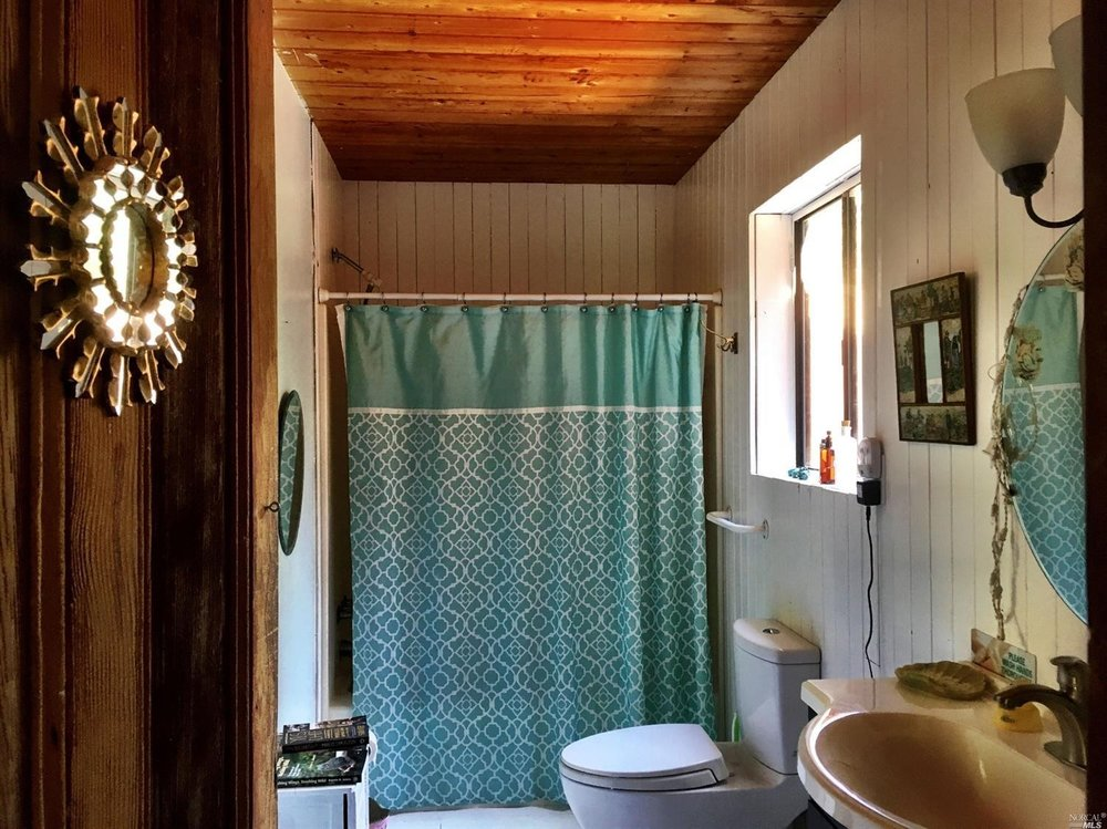 The downstairs bath of a home for sale on Guntly Road in Philo, CA.