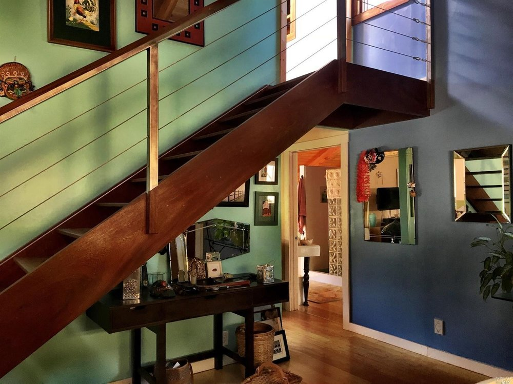 Looking under the stairs to the master suite in a home for sale on Guntly Road in Philo, CA.