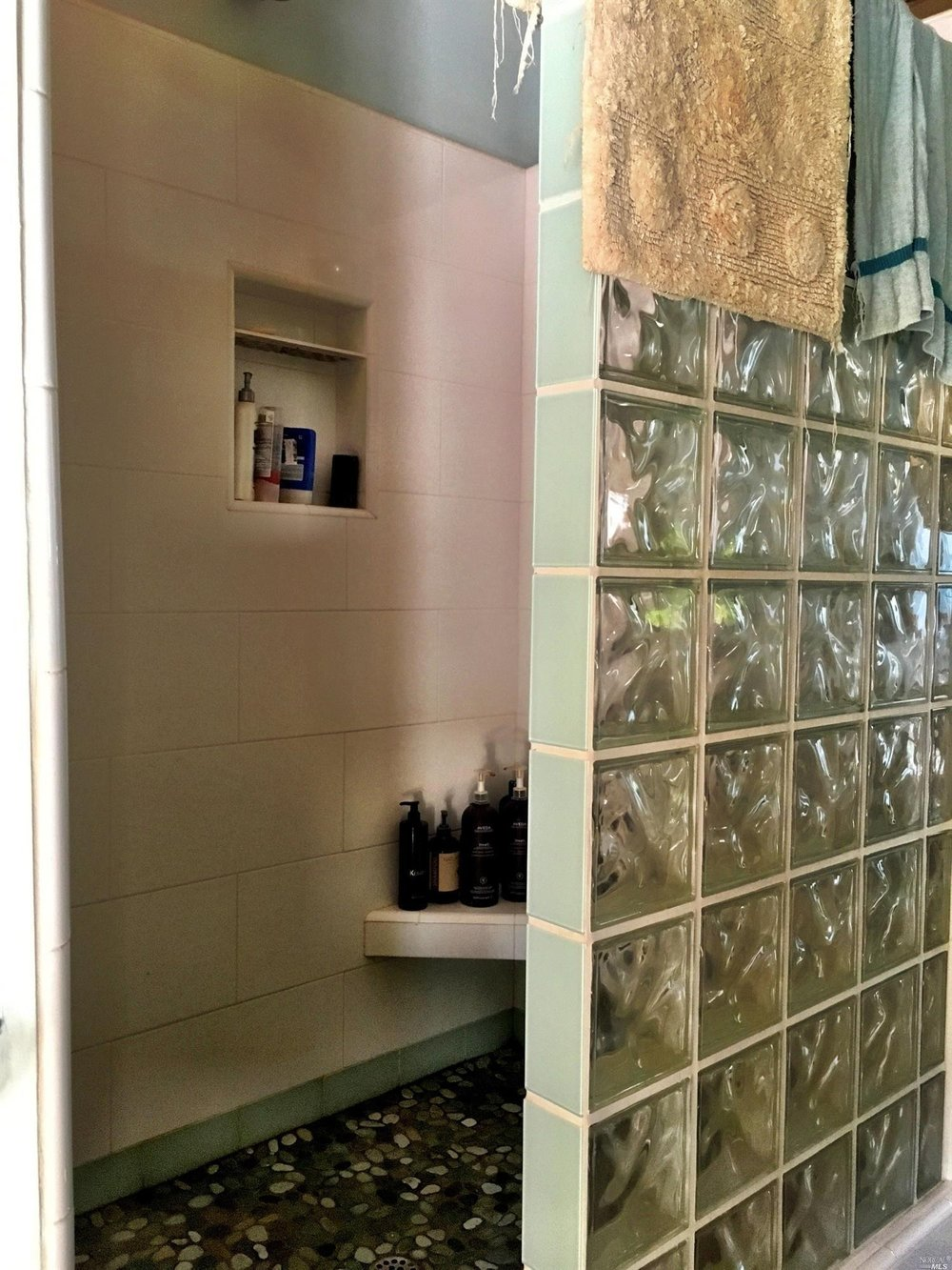 The glassed in shower in a master suite of a home for sale on Guntly Road in Philo, CA.