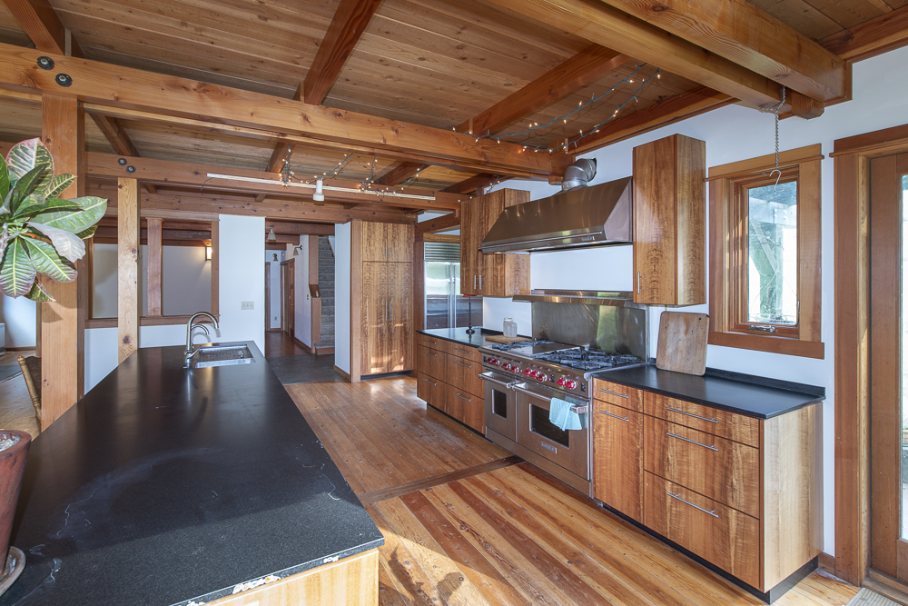 Wood interior and large gourmet kitchen with professional range.