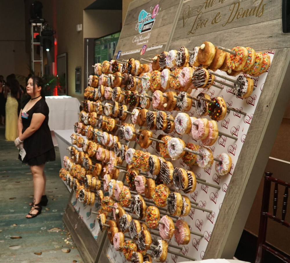 Gigantic Donut Walls with attendant donated to Marjory Stoneman Douglas Prom at the Westin Fort Lauderdale Beach Resort on May 5, 2018