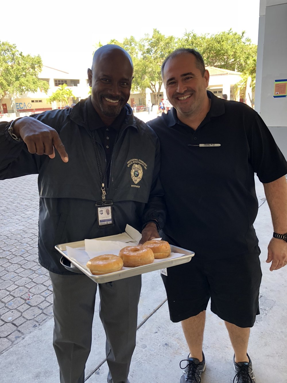 Staff Smiles for Donuts -
