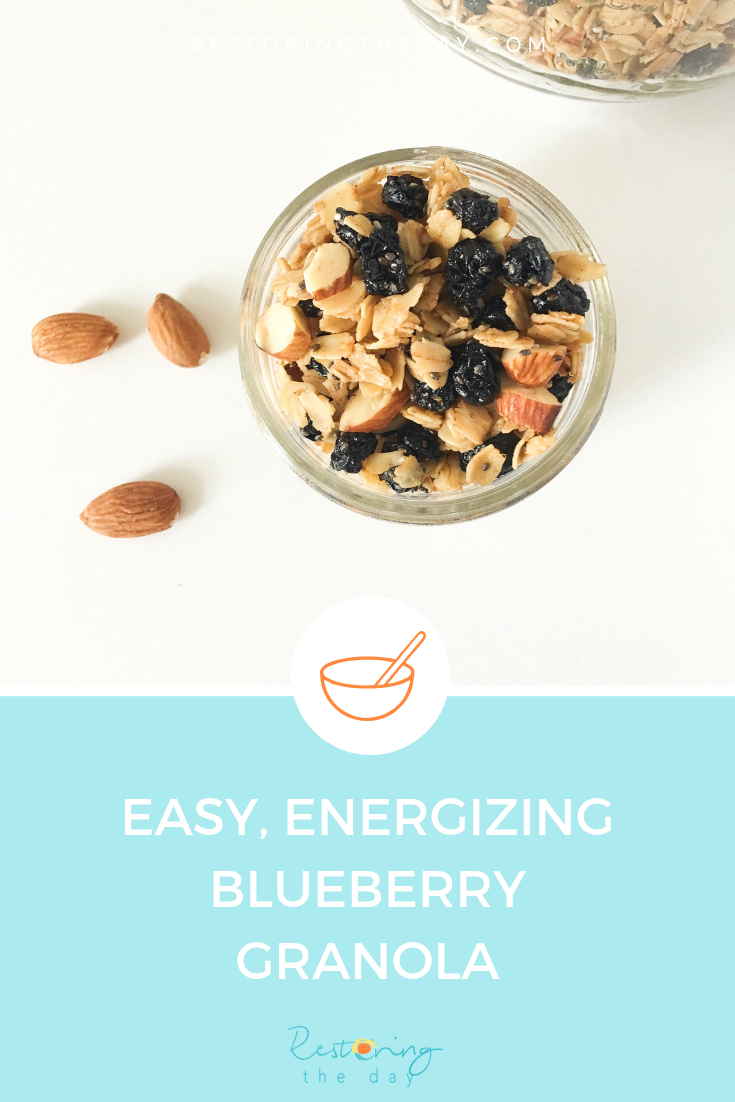 Easy energizing blueberry granola recipe uses raw honey, ghee, chia seeds, almonds, cinnamon and dried blueberries to create this perfectly crunchy cereal or snack or yogurt topper!.png
