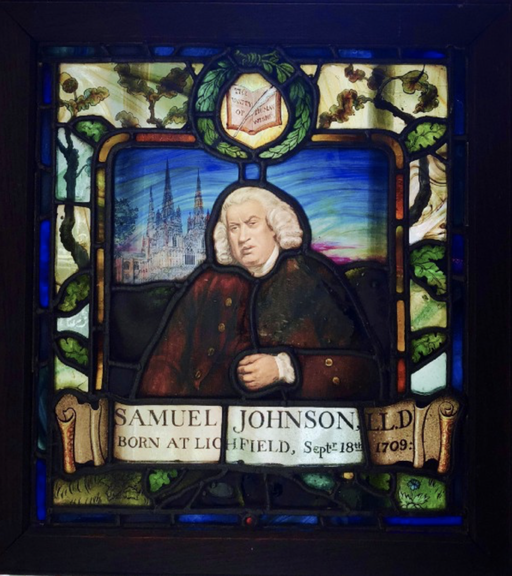 A stained glass image of Dr. Johnson hanging on a window in his home.