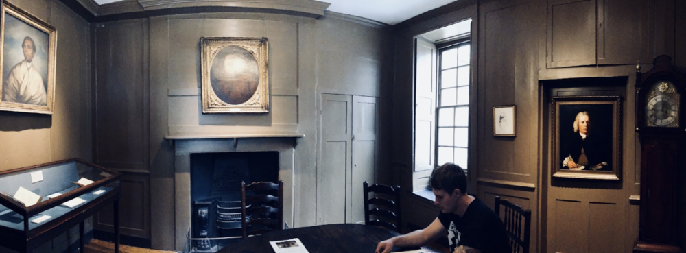 The first floor of Dr. Johnson's London home. Brandon sits, reading informational literature.