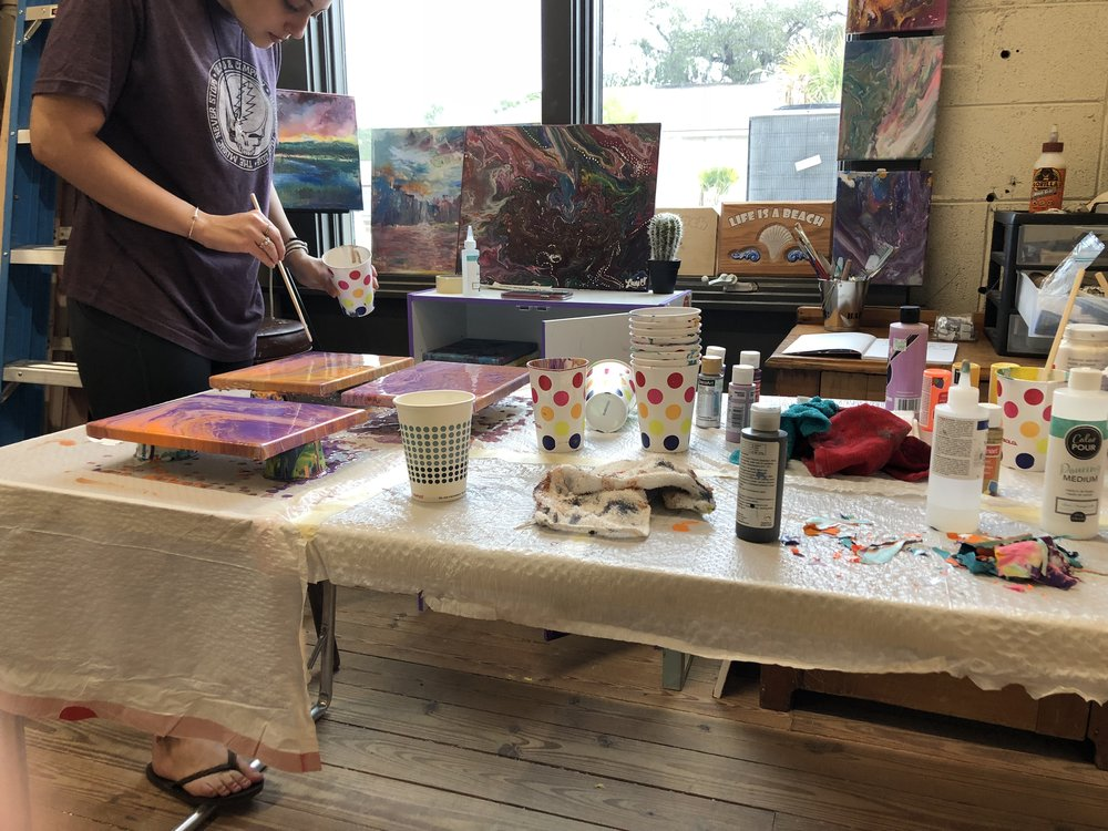 Maddie Terry making some acrylic pours.
