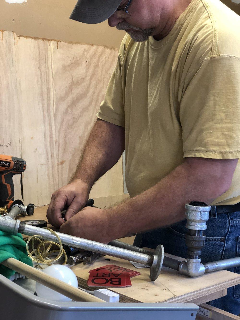 Jack McNulty working on a chandelier