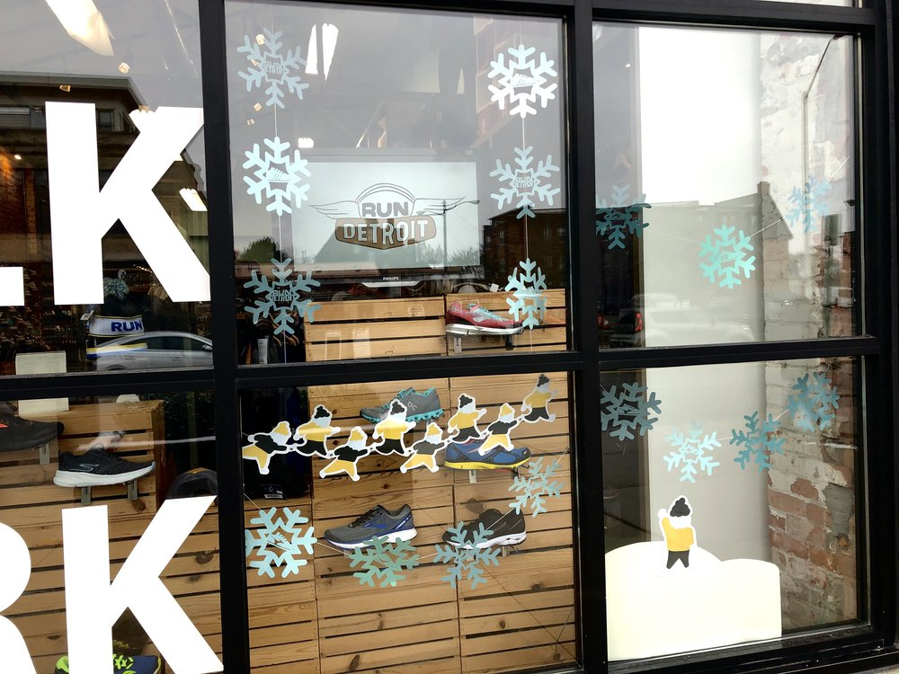 Run Detroit   I was selected to design the window store front for RUNDetroit as part of Lawrence Tech's DCDT Holiday Window Walk competition. My design included a stop motion animation, each frame being individually drawn by hand. As an additional playful element, illustrated runners and snowflakes featuring the store logo and carried products.