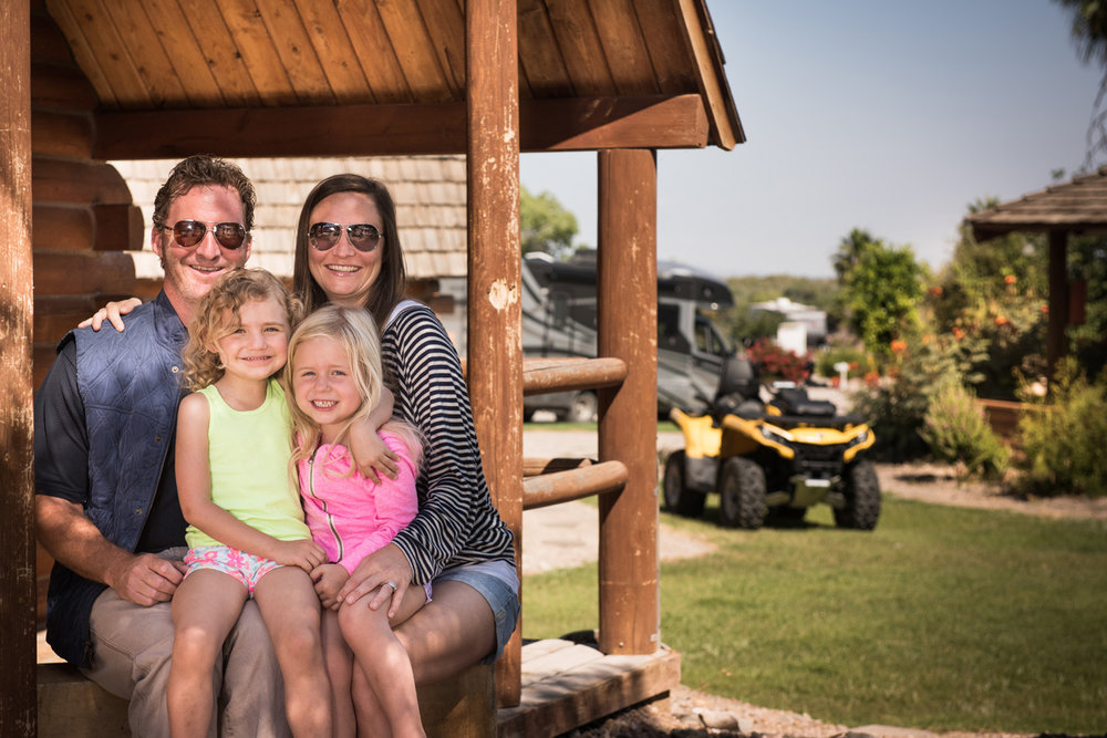 Family in front of cabin at Arizona Oasis.jpg