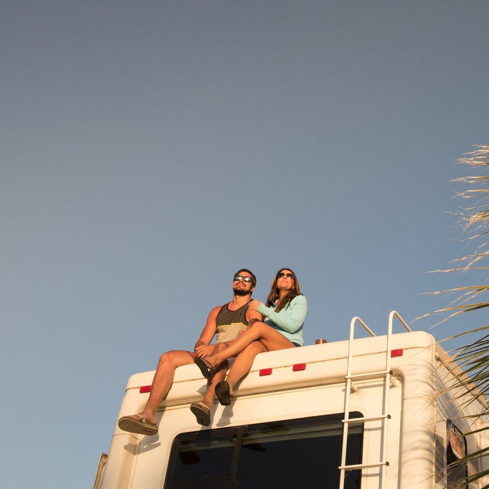 couple-sitting-rv-arizona-oasis.jpg