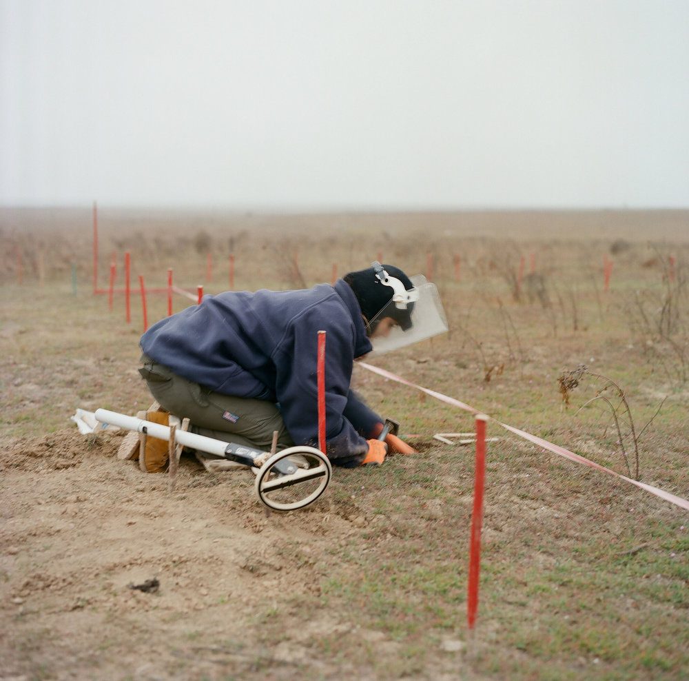 Alvina searches for PMN-2 anti-personnel mines at Marzili. Manufactured in the Soviet Union, these mines can be triggered by any form of pressure and were used heavily during the Nagorno-Karabakh War (1988-1994). While originally designed to disable an adult, a PMN-2 can kill a child.
