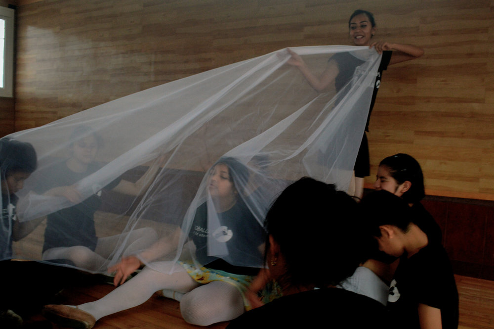 Teacher Lorena Nieva uses translucent fabric in an improvisation