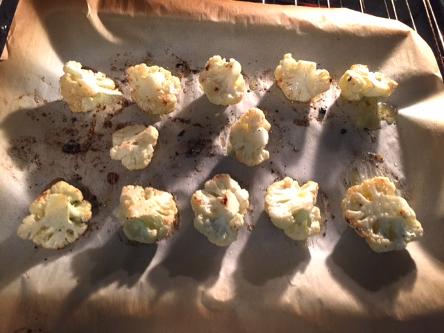 Lemon Garlic Roasted Cauliflower Recipe, roasting on cookie sheet.