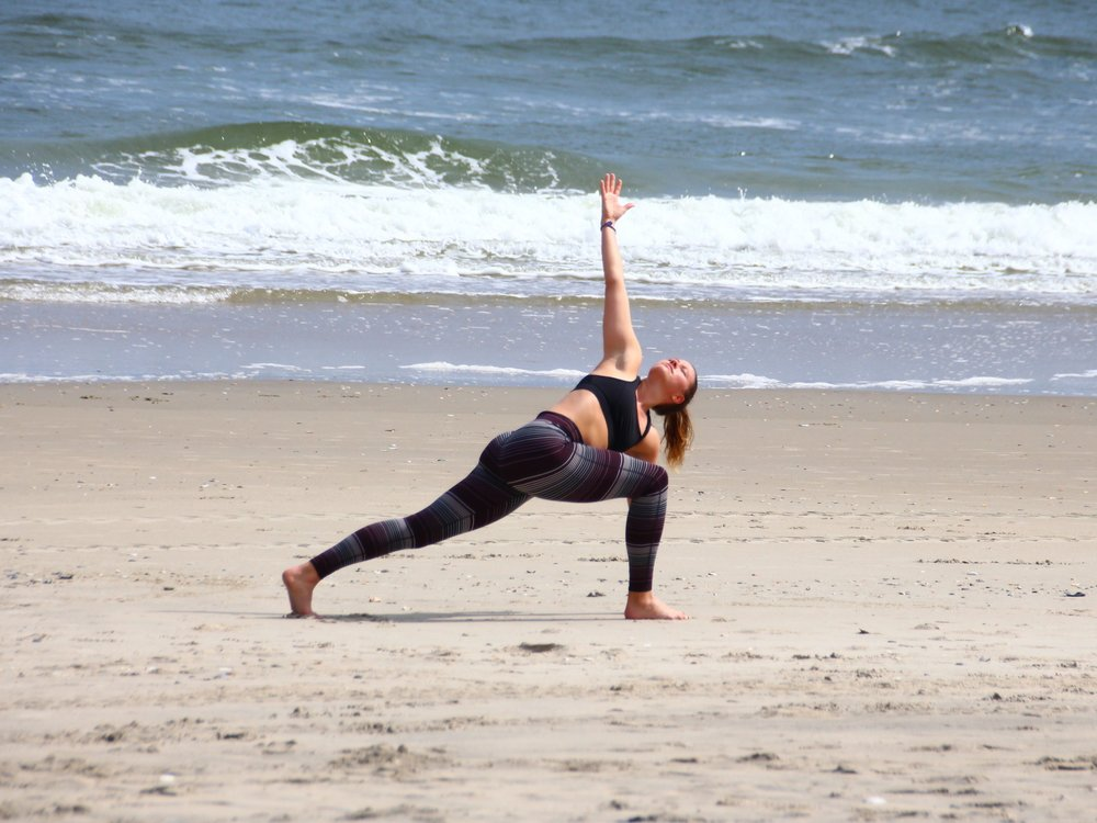 Give it 15  founder Marissa yoga-ing on the beach