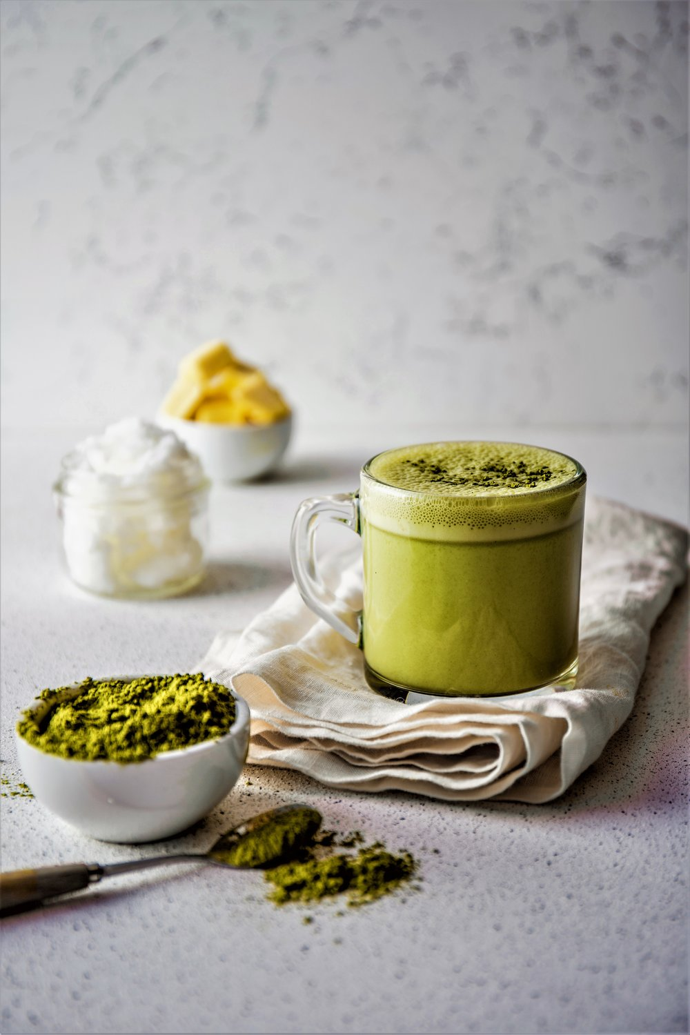 BULLETPROOF MATCHA. Ketogenic keto diet hot drink. Tea matcha blended with coconut oil and butter. Cup of bulletproof matcha and ingredients.jpg