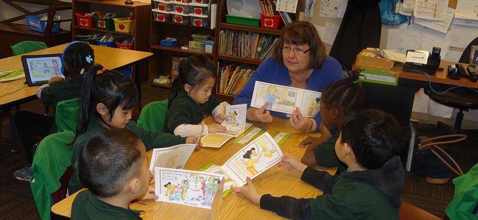 Ms_KA_readingWith_students.jpg