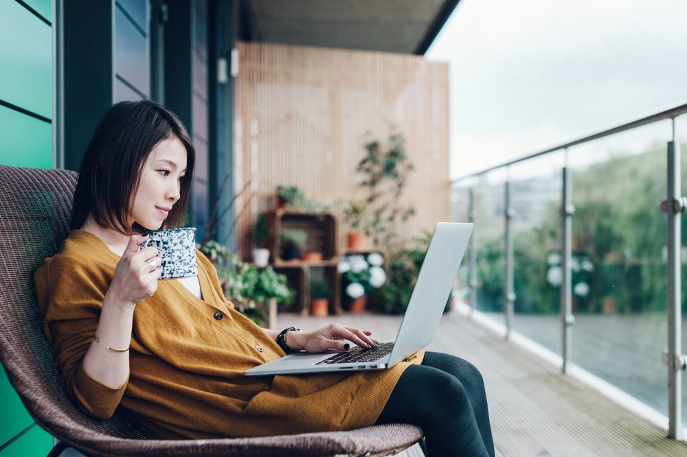 young-woman-working-on-laptop-in-balcony-823364650-5b849941c9e77c00574f06ed.jpg