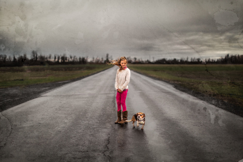 Girl and her dog in a storm. Check out the texture overlapping the image. That's a piece of paper with tea stains on it that I made using the multi-exposure function on my Canon camera.
