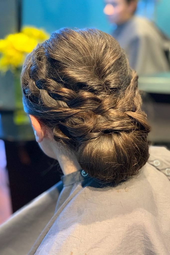 Braided Bun:  if you love braids, and want to add some glam for your big night, this braided bun is the perfect combination! Low and sleek to keep it classy, with a generous side bang in the front to frame your face, you will look stunning on your big night. Consider dressing it up with some adornments for extra pizazz!