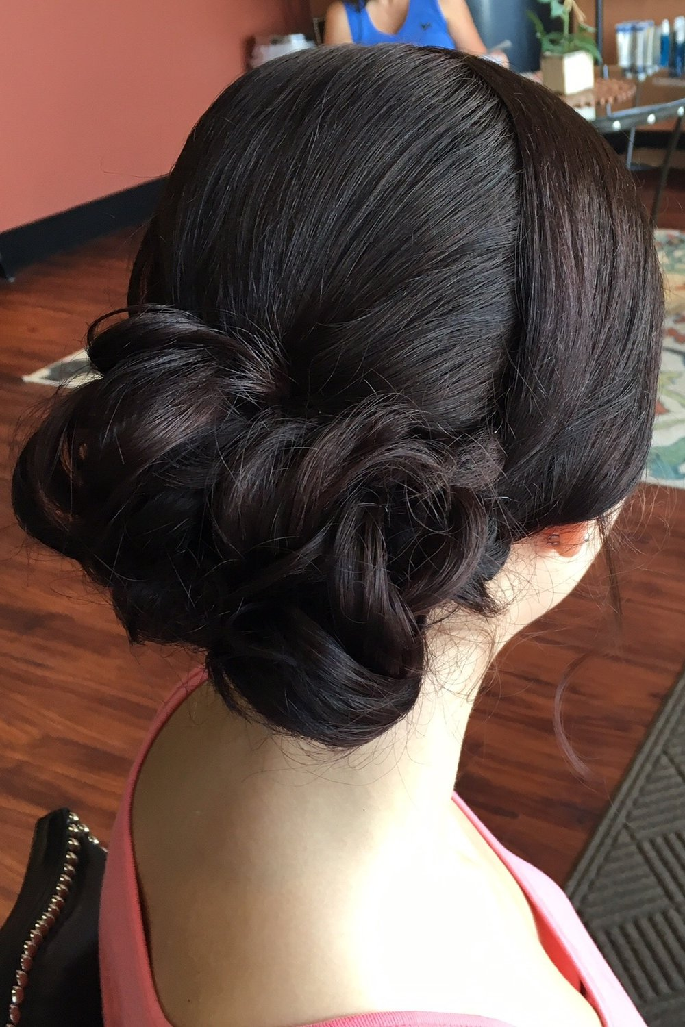 The Pinned Curls:  This beauty is about as classic of an updo as you can get! It is sleek, it is elegant, and it is a go-to style for nearly every type of event! Versatility reigns supreme with this style - dress it up with glitter, flowers, and adornments, or keep it classic and elegant all on it's own! You cannot go wrong with this style. Your photos will thank you.