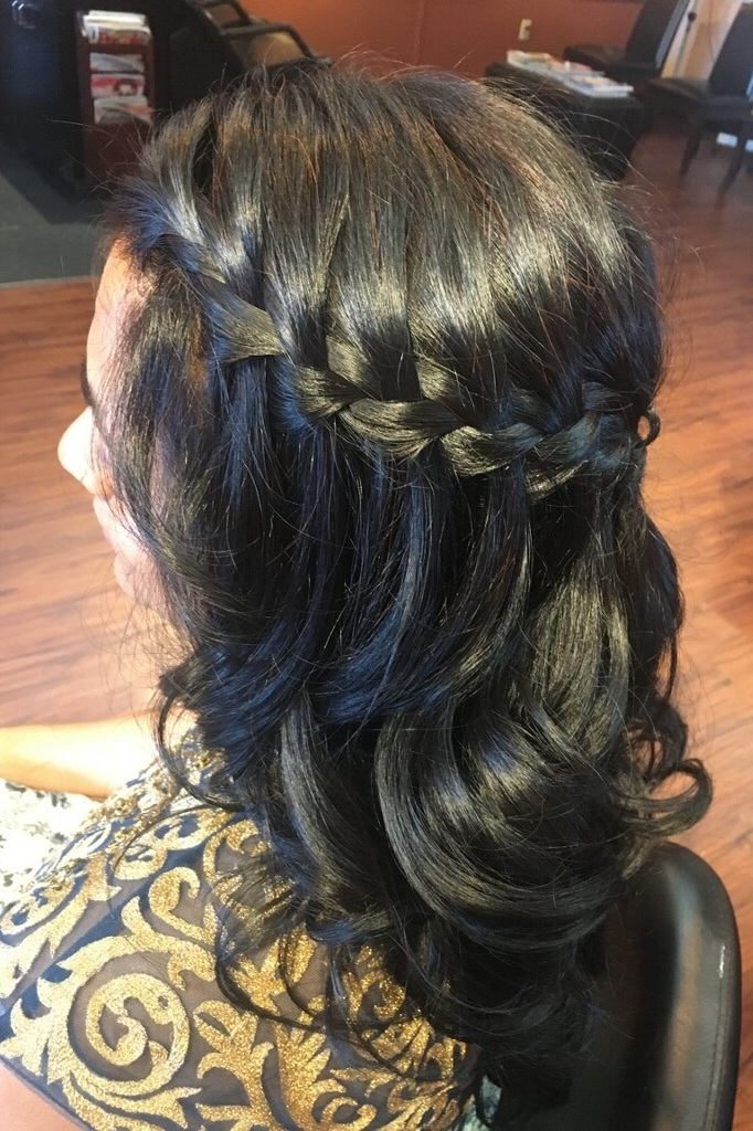 French Braid Crown Half Up:  Fit for a warrior princess, this is a beautiful up-do! The french braids encircling the crown are reminiscent of Aphrodite herself, and will have you feeling confident and empowered all night. The long curls soften the look, and add an ethereal touch so you can dance the night away with the movement of a Goddess.