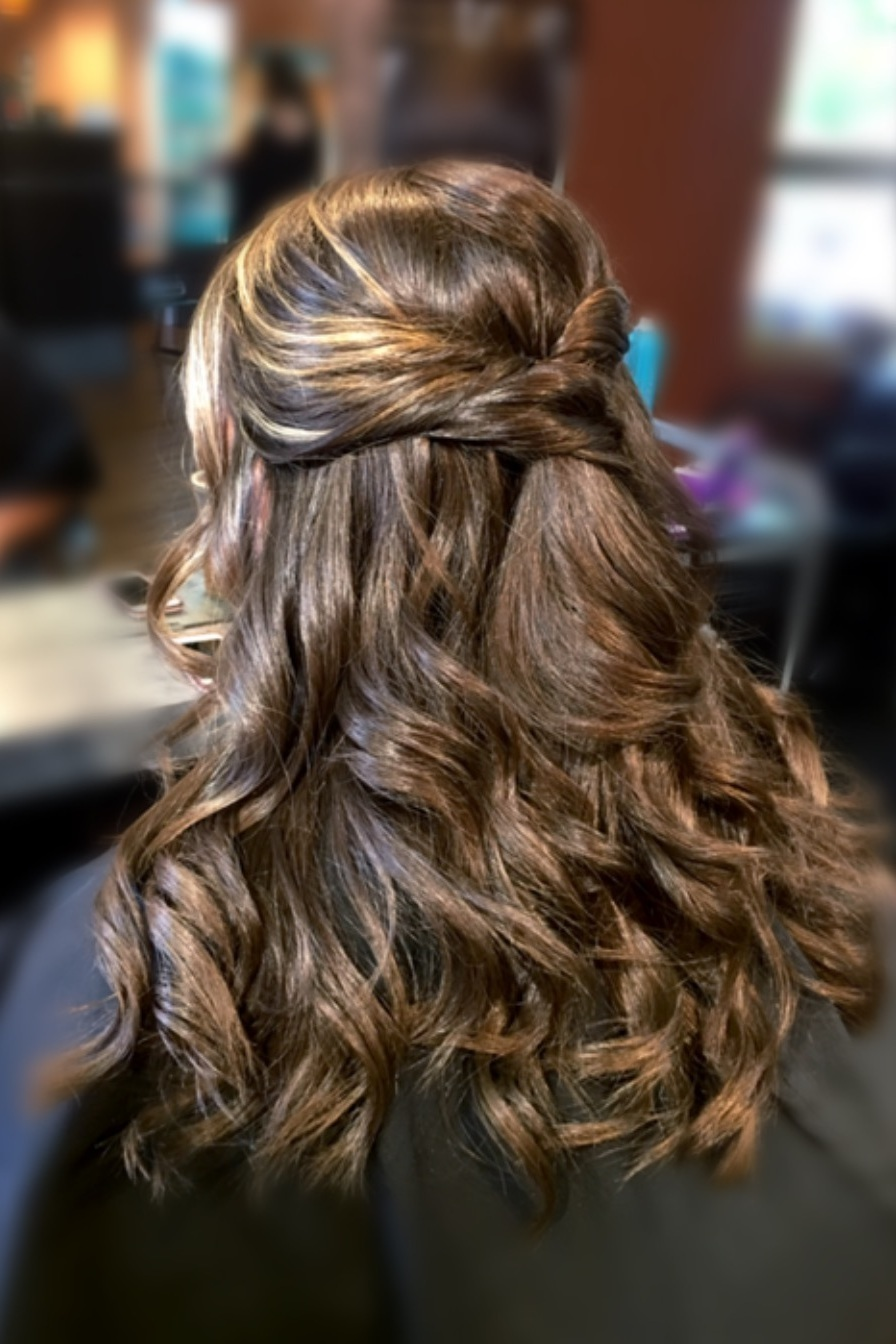 Twisted Half - Up:  This flowy hairstyle has some serious bohemian chic vibes! If you are not a fan of updo's, consider having your tresses long and curled, with a fun twist to add some flair to this classic silhouette.