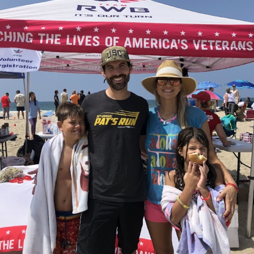 Our family volunteering at a Team RWB event teaching veterans how to surf.