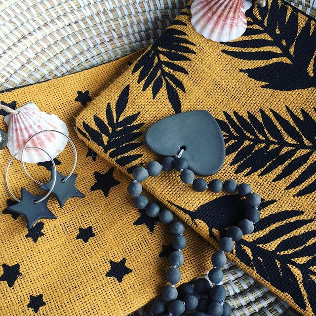 Marigold is the colour of the season! Whether in the warmth of the Caribbean or the cold North, marigold is a must have. Shop marigold jute clutches and LOVE necklaces by @samarahbarbados on our Lookbook (link in bio). If you're in Trinidad, there's still time to get one before Christmas!⠀ .⠀ .⠀ .⠀ #juteclutch #beachaccessories #handmade #madeinbarbados  #comingtotrinidad #saltandpapaya #travelaccessories #beachessentials  #samarahbarbados #samarah  #wateresistant #samarahbarbados #porcelainheart #claynecklace #essentialoils #travelessentials #madeinthecaribbean #wornintrinidad #holidaypopup  #maderesponsibly #lovenecklace #stars #palms #marigold
