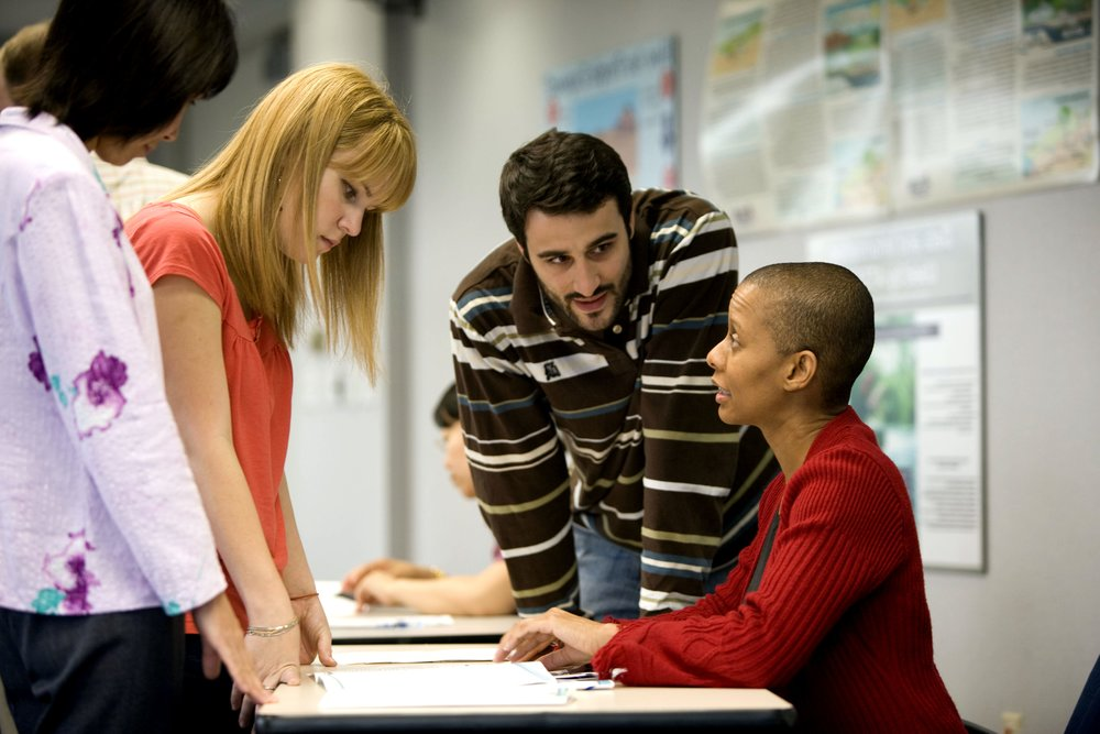 african-american-female-talking-with-two-females-and-one-male-in-her-office.jpg