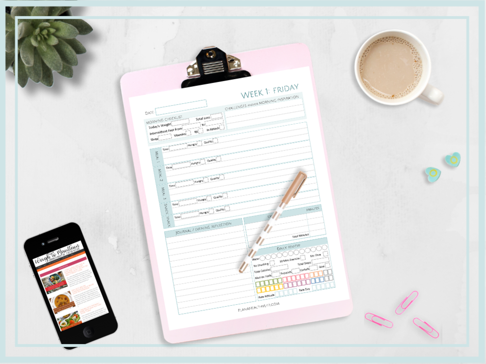 pink clipboard with fitness planner page