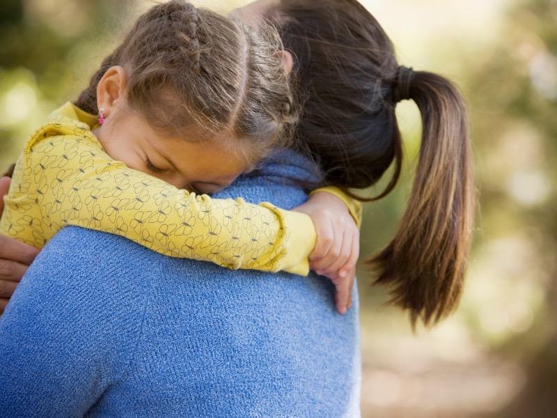 sad-girl-hugging-mom.jpg