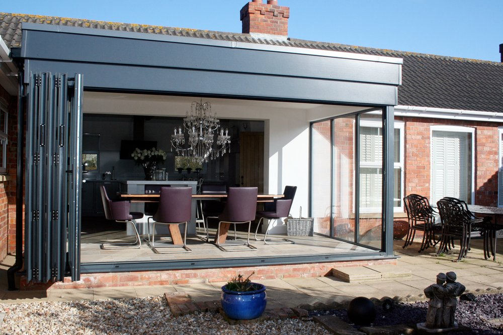 Doors & Conservatories - Composite & PVCu doors | Aluminium Bi-Folding & Sliding Patio doors | French doors | Security doors
