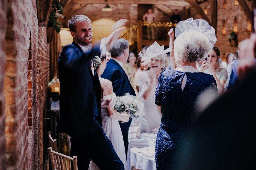 Candid groom shot at Norfolk wedding