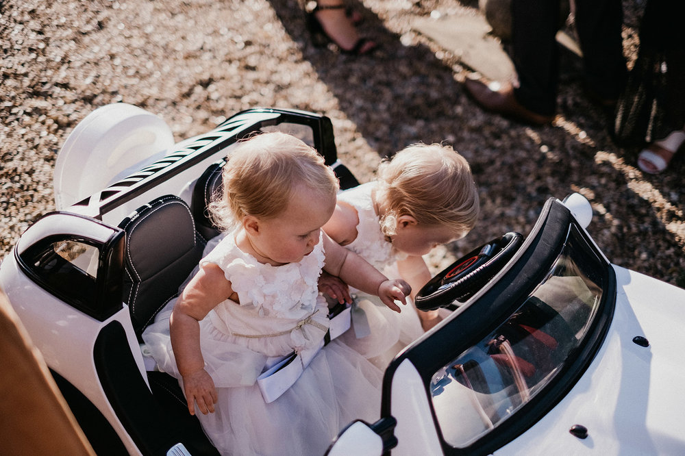 Twin flower girls at Hales Hall and The Great Barn