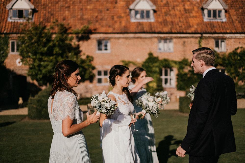 Bride with Bridesmaids at Norfolk wedding