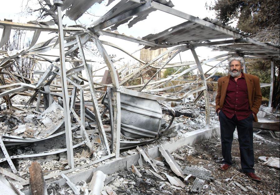 Yoram Raanan beside his burnt studio, November 2016 © Yoram Raanan