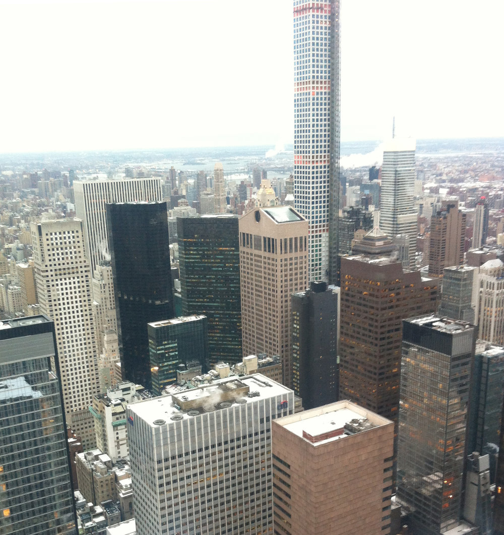 - New York City from the top of the Rockefeller Center, near to the CAA venue, Hilton Midtown, with Philip Johnson's AT&T Building (middle).
