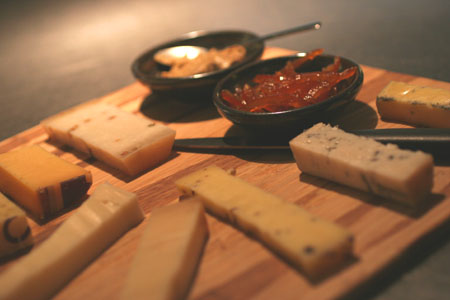 Dutch cheese plate with mustard and tangerine marmalade
