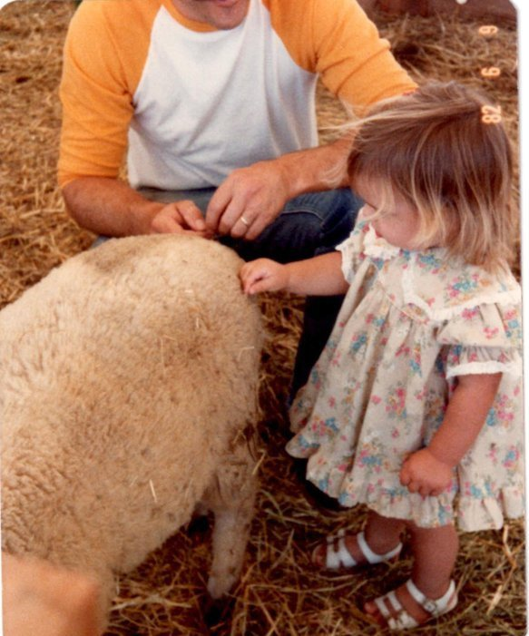 Here I am petting my first sheep. Baby animals still win in cuteness.