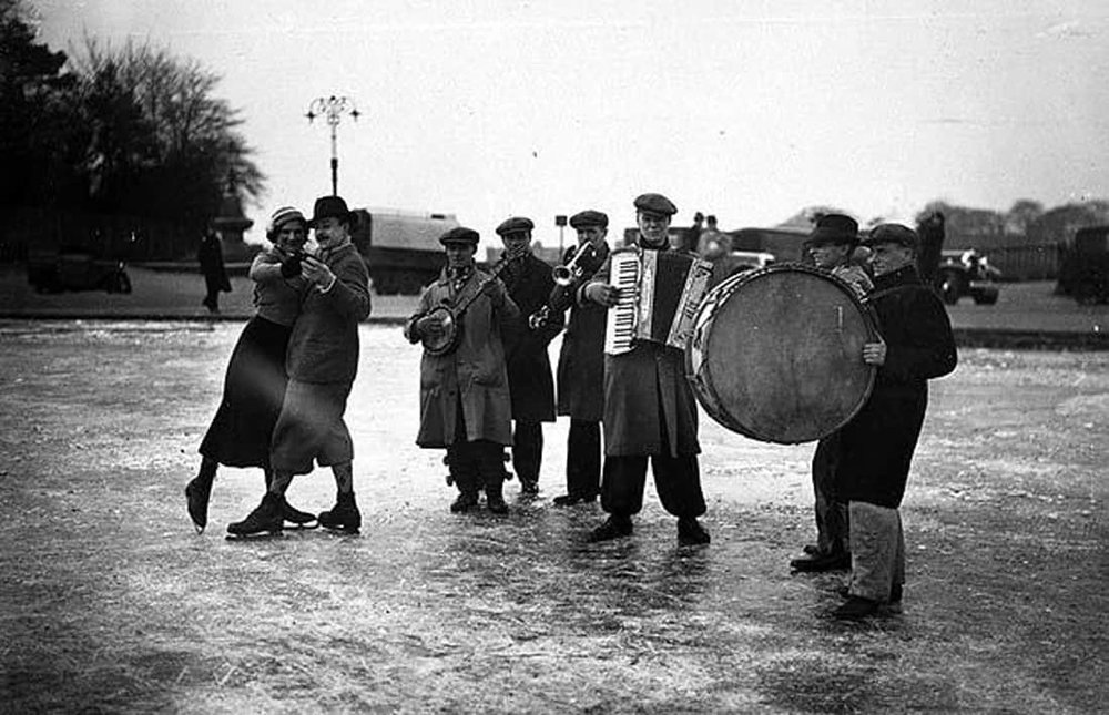 1933 skaters dance to a band on Hampstead Heath's Whitestone Pond on a chilly January day.jpg