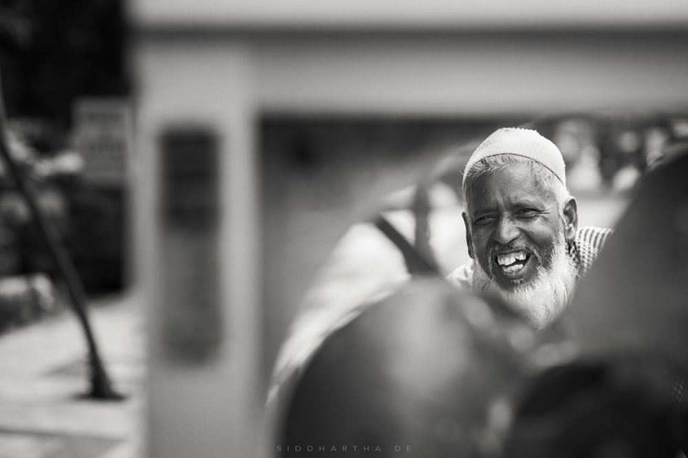 Old Man Behind Fan Portrait 01.jpg