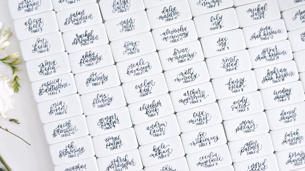 non-traditional wedding place card calligraphy