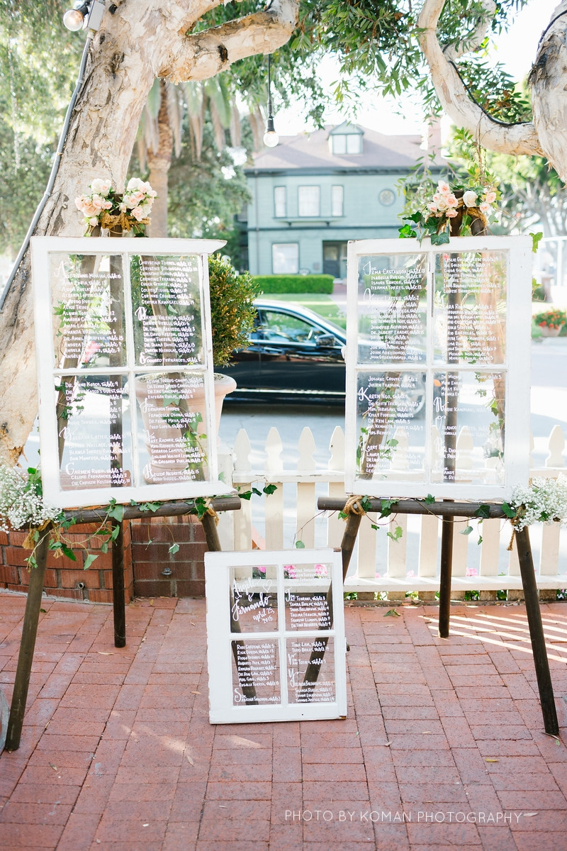 reclaimed window seating chart calligraphy