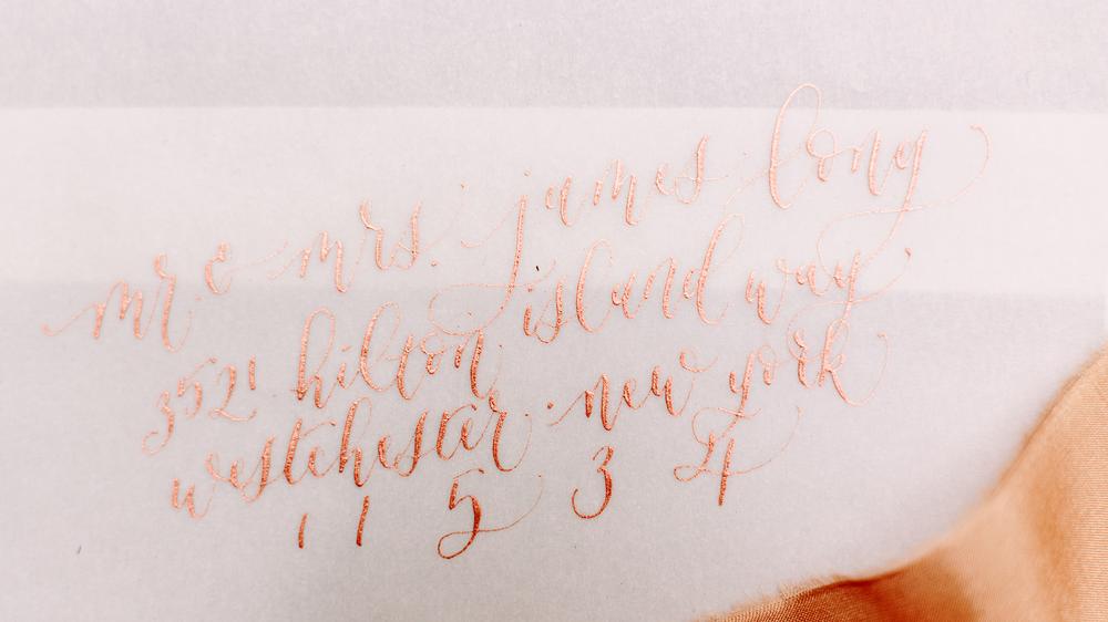 rose-gold-copper-ink-vellum-calligraphy-envelopes-los-angeles.png