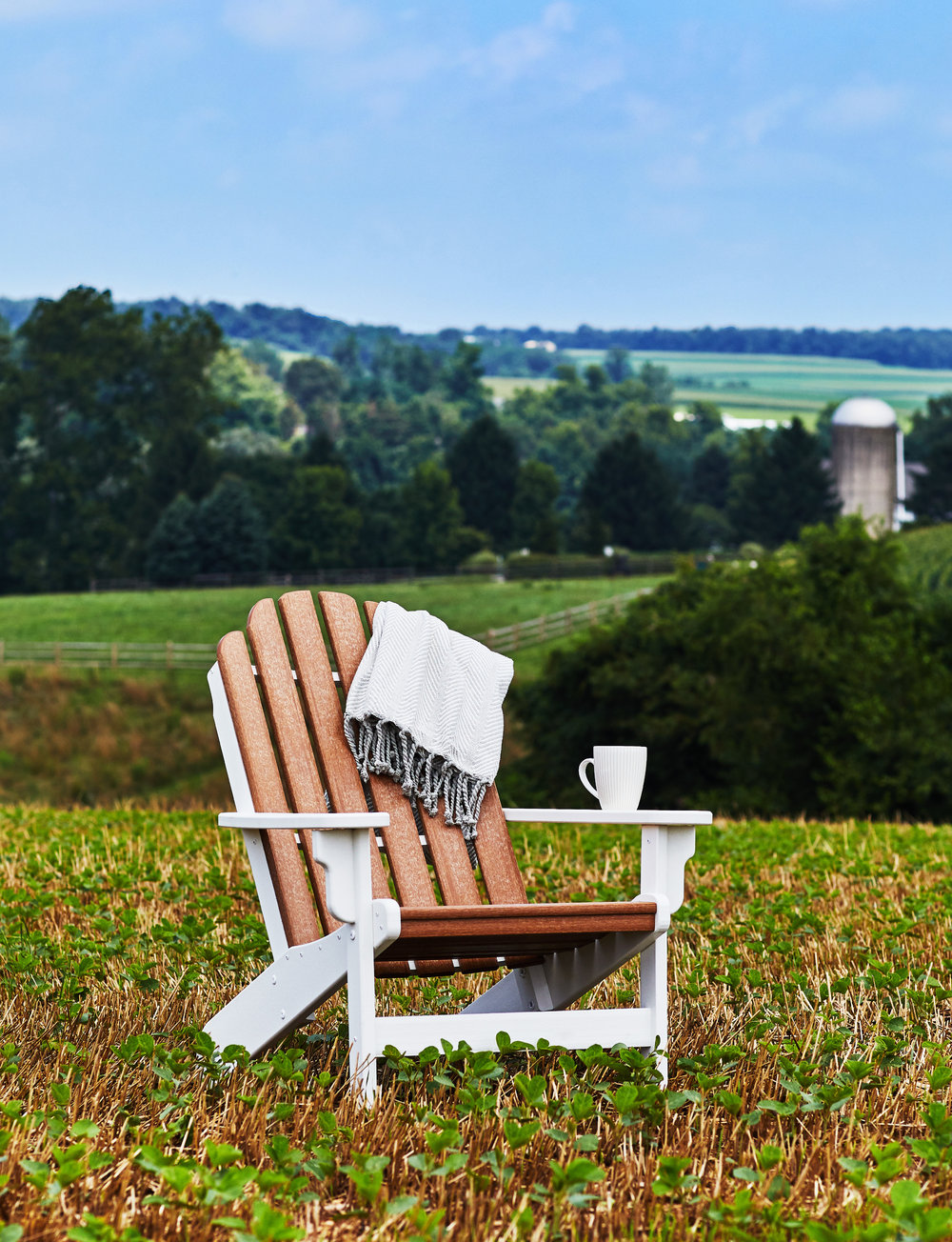 Eco-friendly sustainable Breezesta Shorline Adirondack Chairs made of recycled milk jugs. Durable & maintenance free.