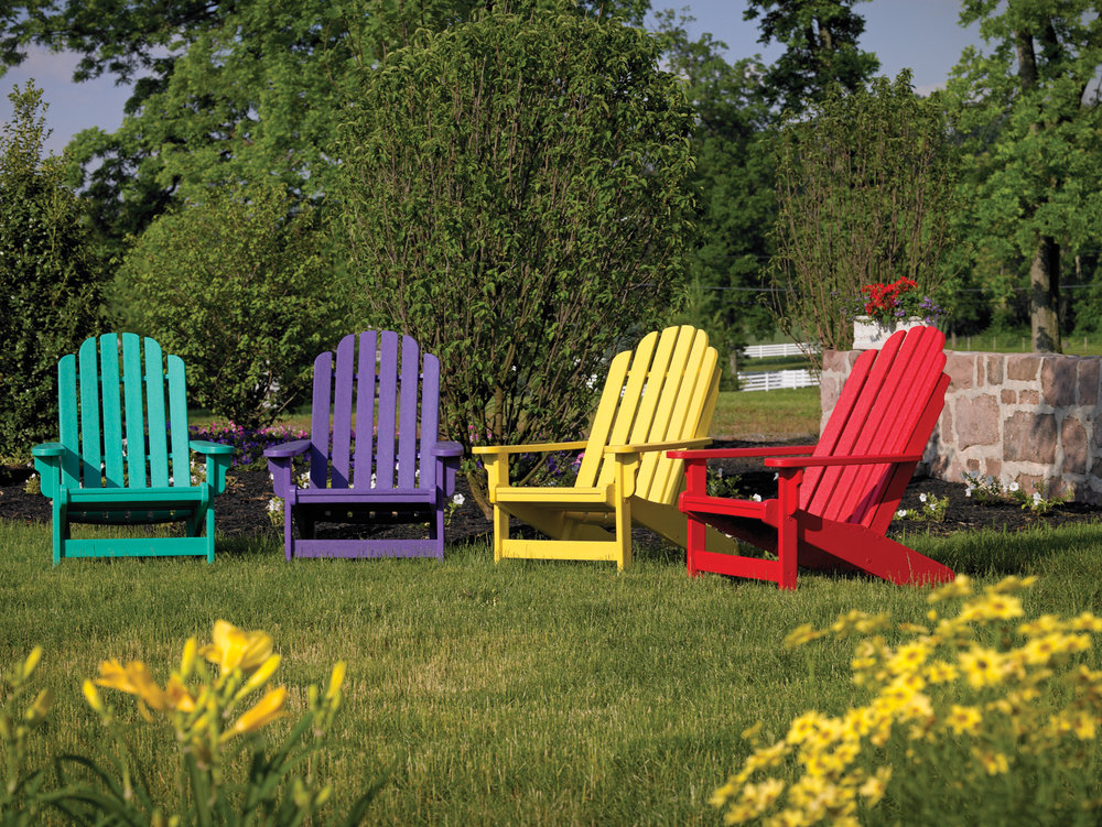 Classic Adirondack chairs are available in a rainbow of solid or two-tone colors. Perfect for relaxed entertaining.