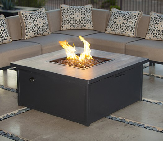 "Creighton wrought iron and cushion contemporary sectional. Creighton 42"" square propane wrought iron frame and porcelain top firepit."