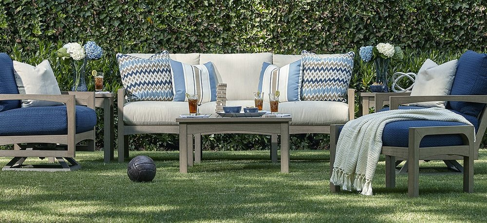 Beautiful faux teak wood furniture by Klaussner offers the beauty & durability of teak wood with none of the maintenance. Del Ray Swivel Rocker Cushion Lounge Chair, Del Ray Cushion Lounge Chair, Del Ray Cushion Ottoman and Del Ray coffee table. Beautiful, comfortable, all weather, low maintenance furniture.