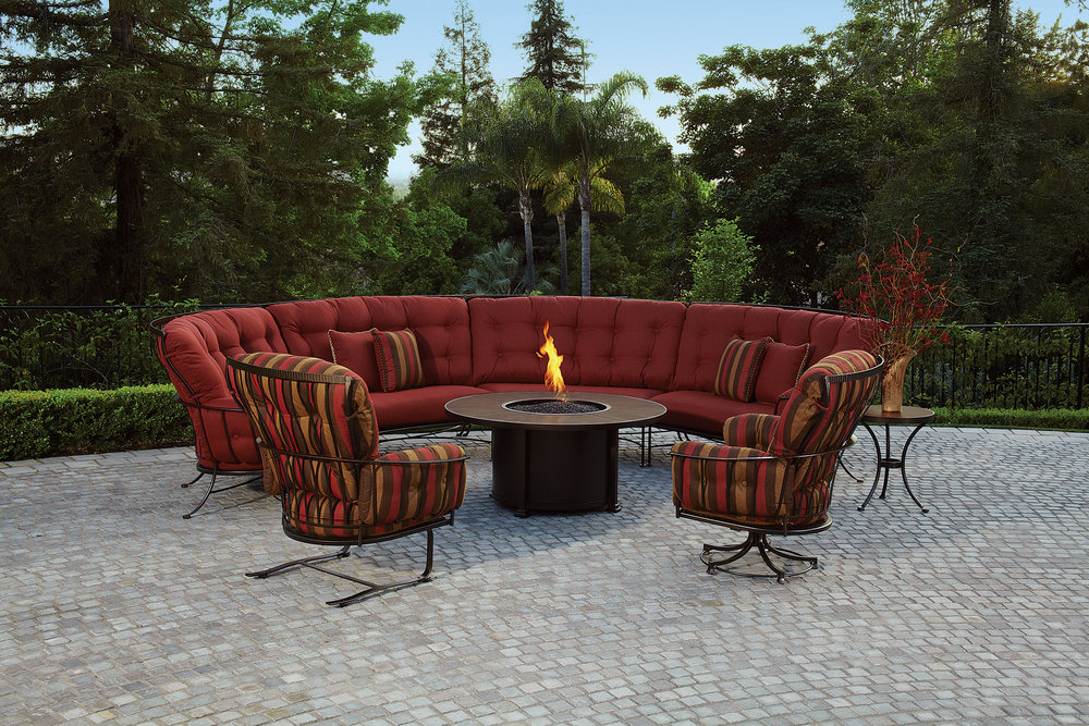 """Monterra Sectional with frames made of powder coated wrought iron with swivel rocker lounge chair and spring rocker lounger chair. OW LEE Firepit has 54"""" porcelain top with wrought iron base and slide out tray for easy propane tank refill."""