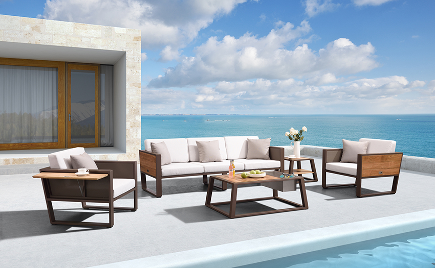 St. Lucia Cushion Group sofa, club chairs, teak top coffee table with built in ice bucket.